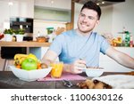 young man having a healthy... | Shutterstock . vector #1100630126