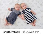 two adorable twin babies posing ... | Shutterstock . vector #1100636444