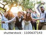 bride  groom  guests posing for ... | Shutterstock . vector #1100637143