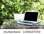 black blank screen laptop on... | Shutterstock . vector #1100637353