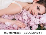 young sexy girl lying on the... | Shutterstock . vector #1100654954