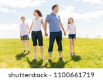 family of four outdoors in a... | Shutterstock . vector #1100661719