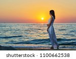 beatiful girl walking alone on... | Shutterstock . vector #1100662538