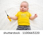 adorable baby wearing t shirt... | Shutterstock . vector #1100665220
