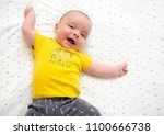 happy little baby boy laughing... | Shutterstock . vector #1100666738