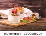 yogurt parfait in glasses with... | Shutterstock . vector #1100685209