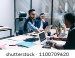 diverse group of professionals... | Shutterstock . vector #1100709620