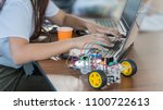 students code a metal car robot ... | Shutterstock . vector #1100722613