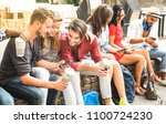 Stock photo multiracial millennials group using smart phone at city college backyard young people addicted by 1100724230