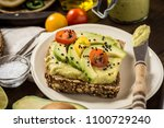 avocado spread guacamole and... | Shutterstock . vector #1100729240