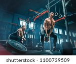 fit young man lifting weight... | Shutterstock . vector #1100739509