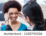 optician showing woman new... | Shutterstock . vector #1100745206