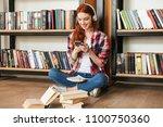 smiling teenage girl doing... | Shutterstock . vector #1100750360