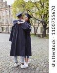 students in mortarboards. two... | Shutterstock . vector #1100755670