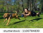 Stock photo the dog pulls for a girl a naughty dog girl in flight for a dog funny not stand on my feet the 1100784830