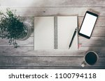 white paper and smartphone on... | Shutterstock . vector #1100794118