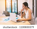 business woman looking at... | Shutterstock . vector #1100830379