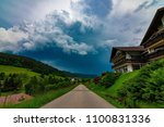 a path leading into a stormy... | Shutterstock . vector #1100831336