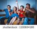 football fans on the couch near ... | Shutterstock . vector #1100834180