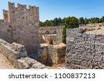 ruins of city walls next to... | Shutterstock . vector #1100837213