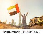 arab emirati man holding uae... | Shutterstock . vector #1100840063