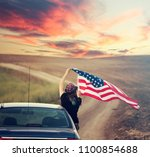 young woman holding american...   Shutterstock . vector #1100854688