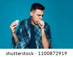 young ailing guy with influenza ... | Shutterstock . vector #1100872919