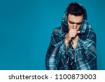 young ailing guy with influenza ... | Shutterstock . vector #1100873003