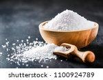 salt in wooden scoop on dark... | Shutterstock . vector #1100924789