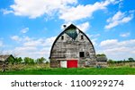 An Old Abandoned Barn Sits...
