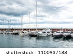 port with yachts in barcelona ... | Shutterstock . vector #1100937188