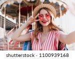 joyful smiling girl in pink... | Shutterstock . vector #1100939168