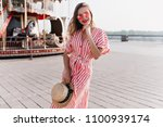 adorable girl in long striped... | Shutterstock . vector #1100939174