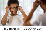 happy little kid trying on... | Shutterstock . vector #1100944289