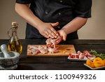 the chef prepares raw quail... | Shutterstock . vector #1100949326