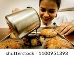 female chef pouring hot... | Shutterstock . vector #1100951393