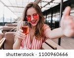 cheerful trendy girl making... | Shutterstock . vector #1100960666