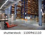 large logistics hangar... | Shutterstock . vector #1100961110
