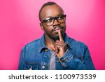 emotions of a pensive african... | Shutterstock . vector #1100973539
