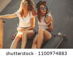two female friends hangout at... | Shutterstock . vector #1100974883