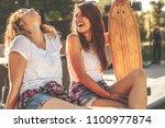 two female skaters best friends ... | Shutterstock . vector #1100977874