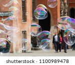 soap bubbles in a city.... | Shutterstock . vector #1100989478