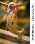 Small photo of padlock of fish