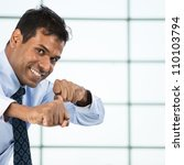 Positive Indian business man with his fist up ready to fight. - stock photo