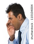 Angry Indian Business man shouting his message. Isolated against a white background. - stock photo