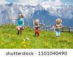 Children Hiking In Alps...