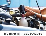 male hand filling car cooling... | Shutterstock . vector #1101042953