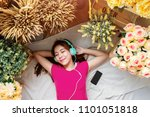 happy young woman laying on the ... | Shutterstock . vector #1101051818