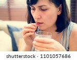 woman taking medication for her ... | Shutterstock . vector #1101057686
