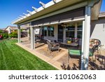 modern rear yard patio with... | Shutterstock . vector #1101062063